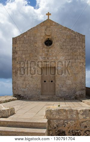 St. Mary Magdalene Chapel was rebuilt on the cliff edge in the seventeenth century. Located in Dingli at the mediterranean island Malta. Intense clouds.