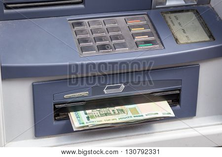 Cash withdrawal. Belorussian ruble banknotes in ATM