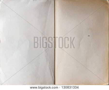 Old book opened to the first page showing blank pages inside.