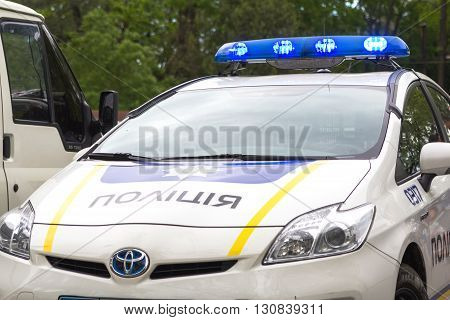 Odesa, Ukraine - May 15, 2016: Ukrainian police patrol car in the park with lights turned on