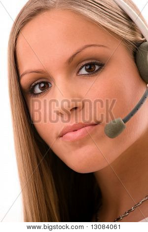 Young female customer service representative in headset, white background.