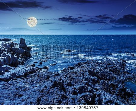 Sea Landscape On The Rocky Coast At Night