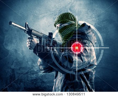 Masked terrorist man with gun and laser target on his body concept  poster