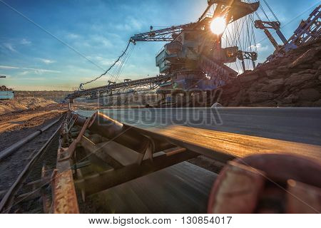 Long conveyor belt transporting ore to the power plant