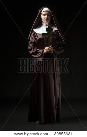 Full growth photo of young catholic nun with orthodox cross