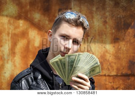 teenager showing off their money. close up