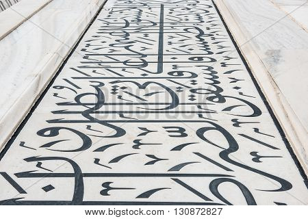 Caligraphy of Persian poems illustrated on the walls of Taj Mahal at Agra, Delhi. Built with Makrana marble of white color, Taj Mahal looks splendid depicting classic Mughal artwork.