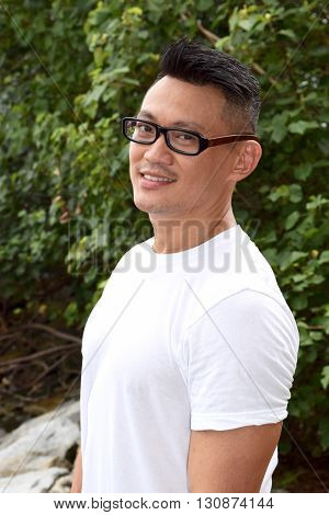 A handsome mature asian man smiling for the camera