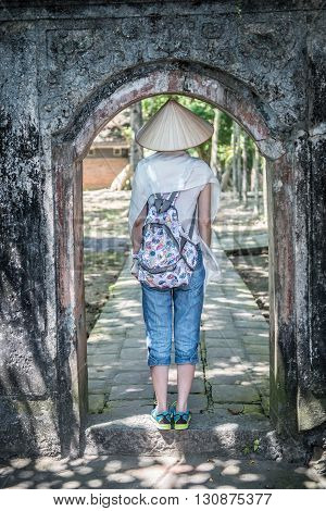 Tourist inside a building in Hoa Lu ancient capital in Ninh Binh. Hoa Lu was the capital of Vietnam between 10th and 12th Century AD and is one of the few Imperial capitals in Vietnam.