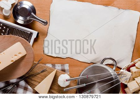 Utensils and food Fondue and a piece of paper