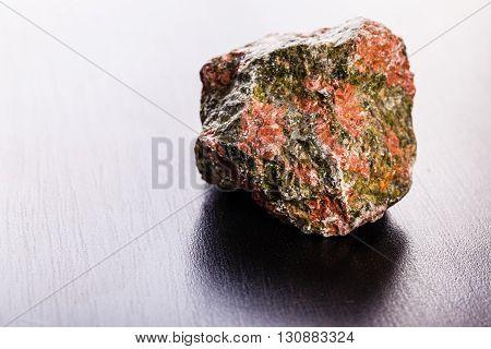 Unakite Stone On Wood