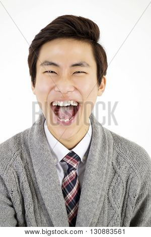Laughing young man isolated on white background
