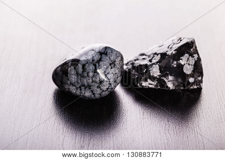 Obsidian Stones On Wood