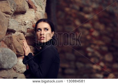 Scared Gothic Victorian Princess Near Castle Wall