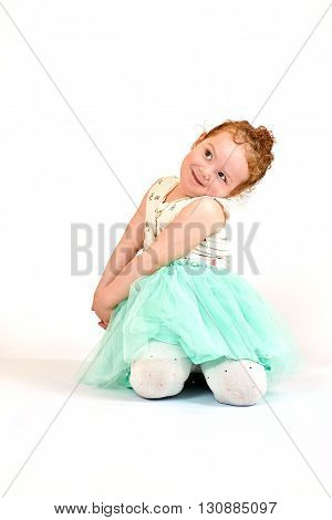 Fashion little girl in green dress in catwalk model pose stock photo. Image 07
