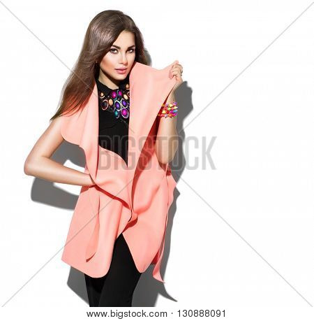 Fashion Model girl isolated over white background. Beauty stylish brunette woman posing in fashionable clothes in studio. Casual style with beauty accessories. High fashion urban style