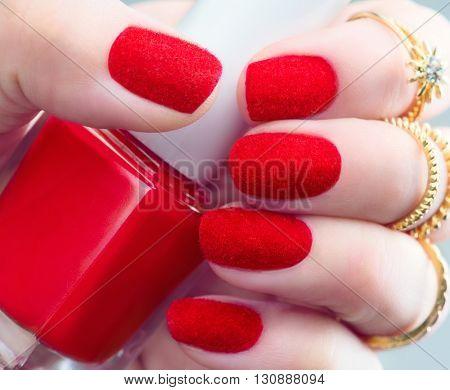 Velvet nails. Fashion trendy red fluffy nail art design closeup. Beauty hands. Stylish Nailpolish