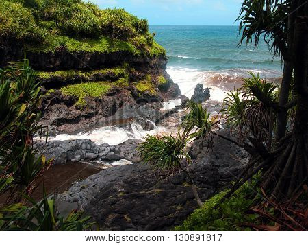 Seven Sacred Pools, Maui: Ohe'o Gulch meets the Pacific ocean in a beautiful landscape of tropical rainforest and cliffs.