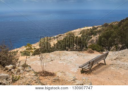 At the top of the Dingli Cliffs wooden bench with a panoramic sea view. Mediterranean island Malta.