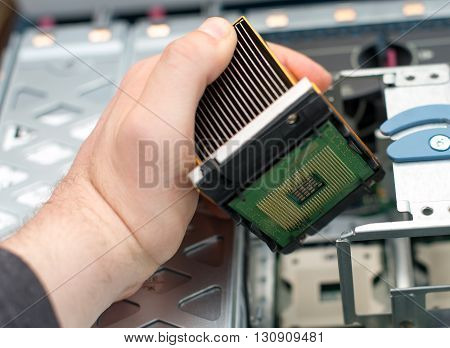Computer technician installing CPU into the motherboard.