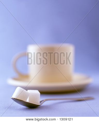 Two Sugar Cubes With A Cup Of Coffee On A Saucer
