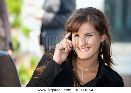 Young businesswoman talking on mobile phone, outdoors.