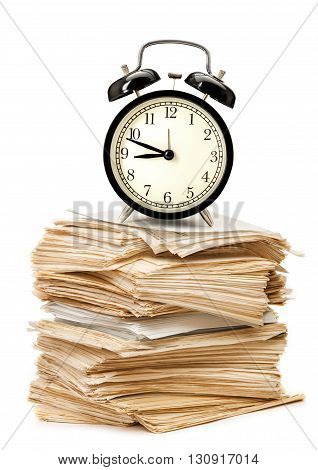 Stack Of Old Papers And Alarm Clock