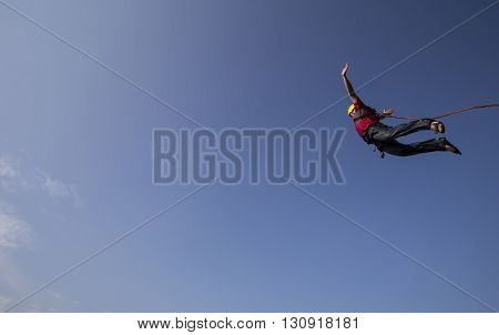 Man Jumping Off A Cliff.