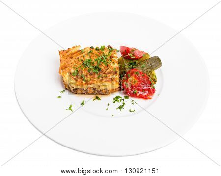 Traditional shepherd pie with lamb forcemeat and pickles. Isolated on a white background.
