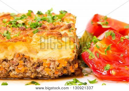 Traditional shepherd pie with lamb forcemeat and pickles. Macro. Photo can be used as a whole background.