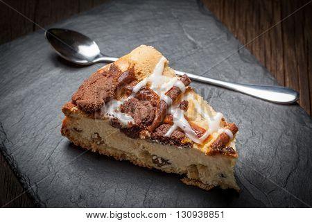 Cheesecake With Raisins On A Slate Plate.