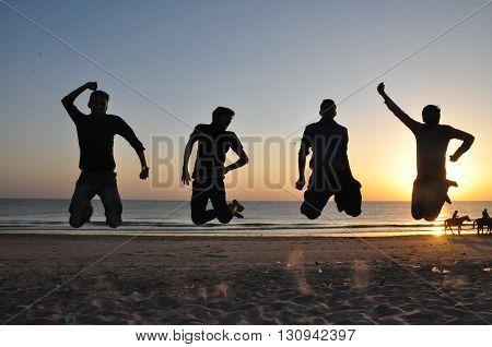 Happiest Jump With Friends Along With Sunset.