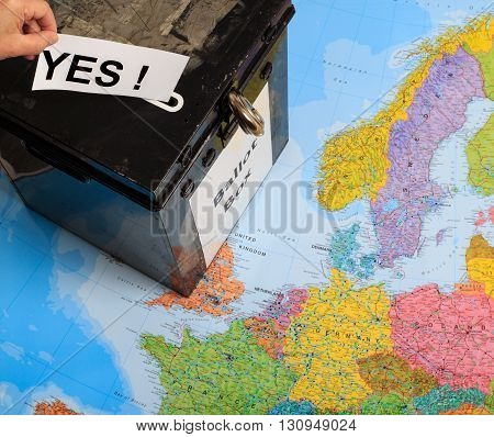 MANSFIELD ENGLAND - MAY 13: UK ballot box on top of a map of Europe. Man's hand putting in a