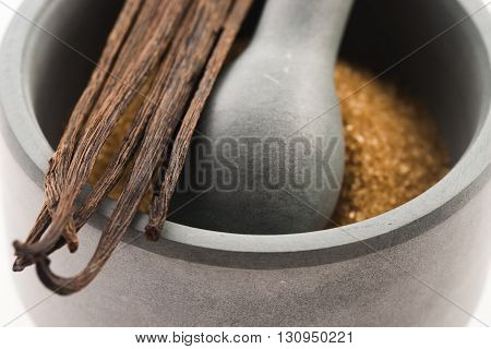 Brown Vanilla Sugar And Vanilla Beans In Mortar
