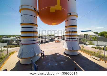 KENNEDY SPACE CENTER FLORIDA USA - APRIL 27 2016: Boosters and fuel tank in front of the the entrance of the building where Space Shuttle Atlantis is exhibited at the visitor complex of Kennedy Space Center