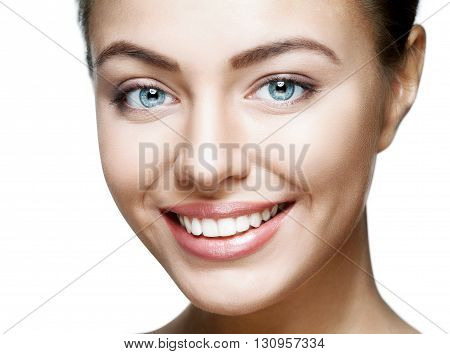 Beautiful woman face. Perfect toothy smile. Caucasian young girl close up portrait. Isolated on white background. Studio shot . happy positive girl.