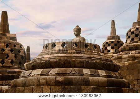 The head of a Buddha statue in the Borobudur temple Indonesia