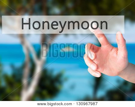 Honeymoon - Hand Pressing A Button On Blurred Background Concept On Visual Screen.