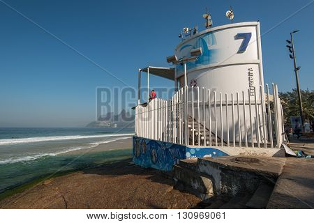 RIO DE JANEIRO, BRAZIL - MAY 7, 2016: Lifeguard post 7 stands on the rock in Arpoador beach.
