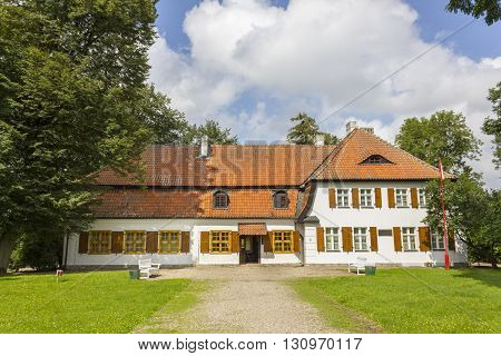 BEDOMIN, POLAND - AUGUST 14: Historic manor house, which is located the Museum of the Polish National Anthem on August 14, 2011 in Bedomin.