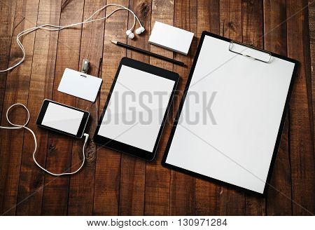 Photo of blank corporate identity template wooden table background. Template for branding identity. Blank stationery mock-up for designers portfolios. Top view.