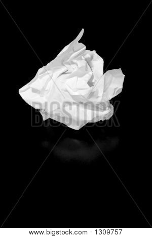 a piece of discarded paper isolated on black poster