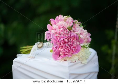 Beautiful wedding bouquet of pink peons, close up