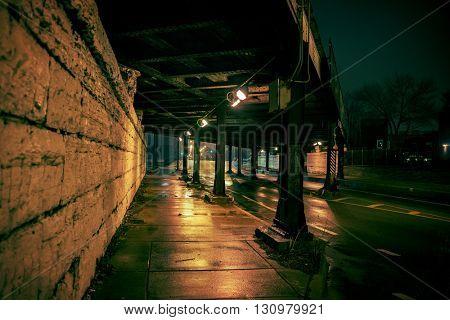Dark Urban Railroad Bridge at Night