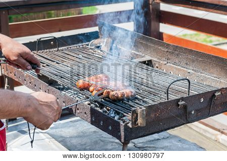 Sausages on a grill outdoor for a barbeque party