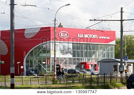 Building Of Kia Motors Car Selling And Service Center With Kia Sign.