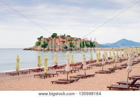 Luxury Sand Beach near Island and Resort Sveti Stefan in Budva, Montenegro. Balkans, Adriatic sea, Europe.