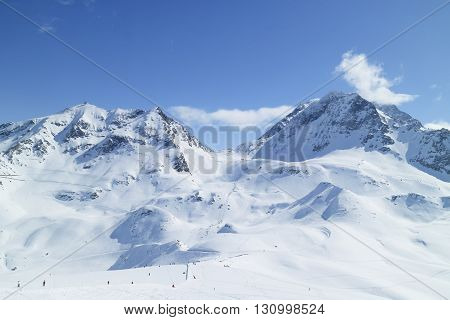 Alpine resort of Les Arcs with ski slopes on snowy French Alps mountains