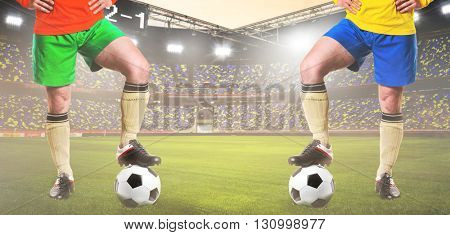 two rival soccer or football players are standing on stadium