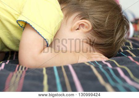 Little girl crying hiding her face taken offense